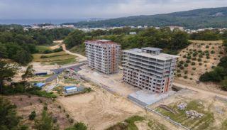 Neue Wohnungen in Avsallar Alanya mit Natur und Meerblick, Foto's Bau-1