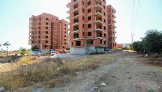 Real Estate in Antalya with Panoramic City and Sea Views, Construction Photos-1