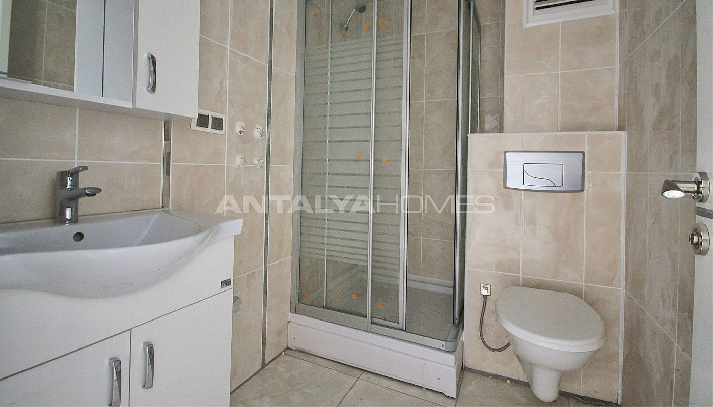 New cheap apartment for sale in antalya with kitchen for Cheap bathroom appliances