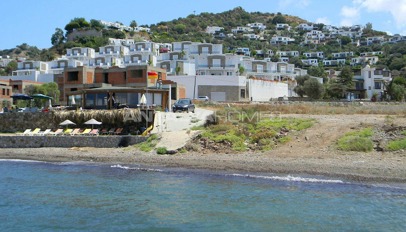 Bodrum seafront white villa seafront villa for sale in for Seafront homes